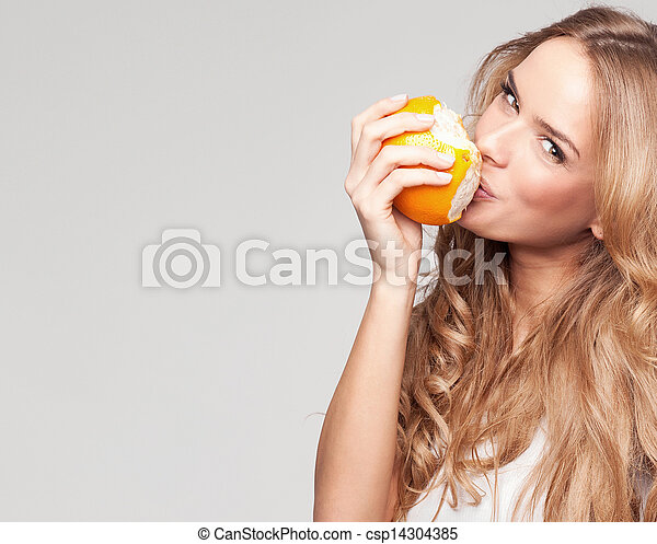 Portrait of a young beautiful woman with orange - csp14304385