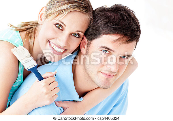 Portrait of a young bright couple painting their new room - csp4405324
