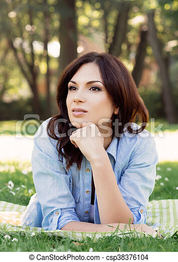 Portrait of a young brunette woman in the park - csp38376104