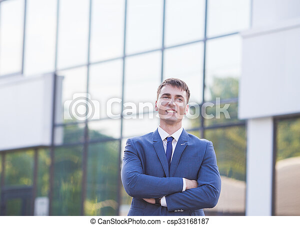 Portrait of a young businessman standing over blurred background  - csp33168187