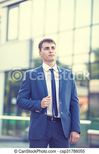 Portrait of a young businessman standing over blurred background  - csp31786055