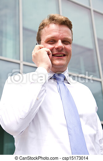 Portrait of a young businessman talking on the phone  - csp15173014