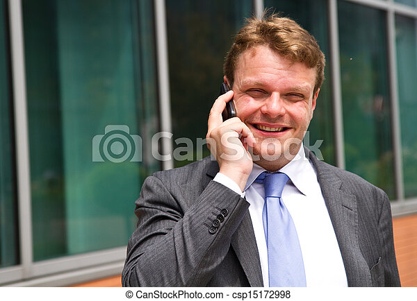 Portrait of a young businessman talking on the phone  - csp15172998