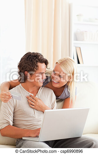 Portrait of a young couple buying online - csp6990896