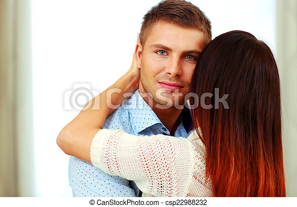 Portrait of a young couple hugging - csp22988232