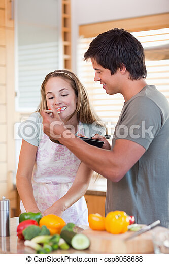 Portrait of a young couple preparing dinner - csp8058688