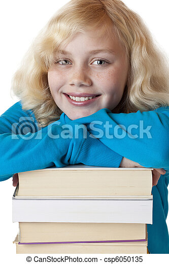 Portrait of a young girl leaning on a pile of books. - csp6050135