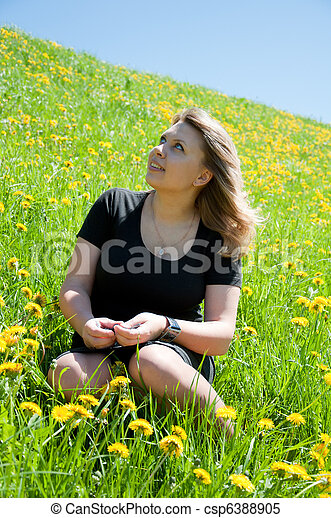 Portrait of a young girl on the lawn - csp6388905
