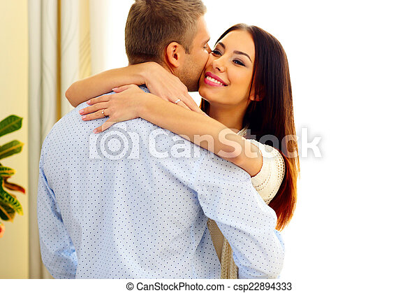Portrait of a young happy couple hugging - csp22894333