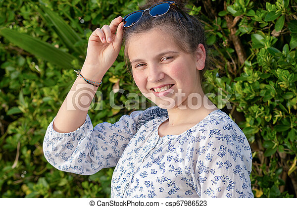 portrait of a young teen girl with sunglasses outdoor - csp67986523
