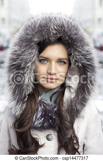 Portrait of a young woman on the background of a winter city - csp14477317