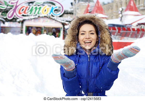 Portrait of a young woman on the background of a winter city - csp12415683