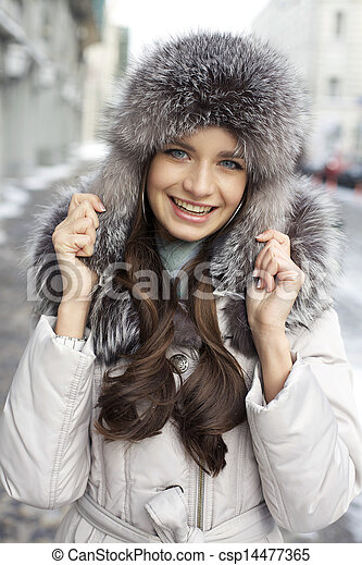 Portrait of a young woman on the background of a winter city - csp14477365