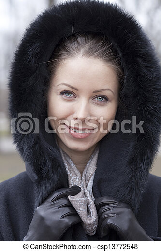 Portrait of a young woman on the background of a winter city - csp13772548