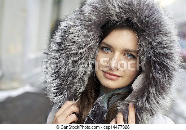 Portrait of a young woman on the background of a winter city - csp14477328