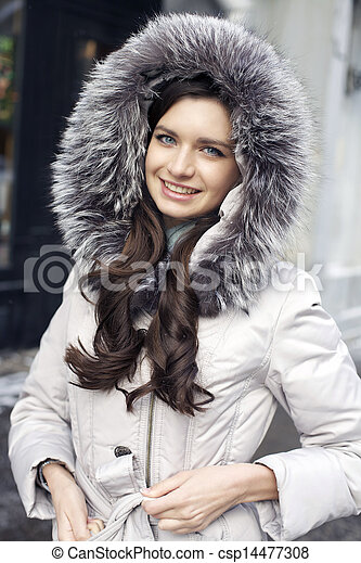 Portrait of a young woman on the background of a winter city - csp14477308