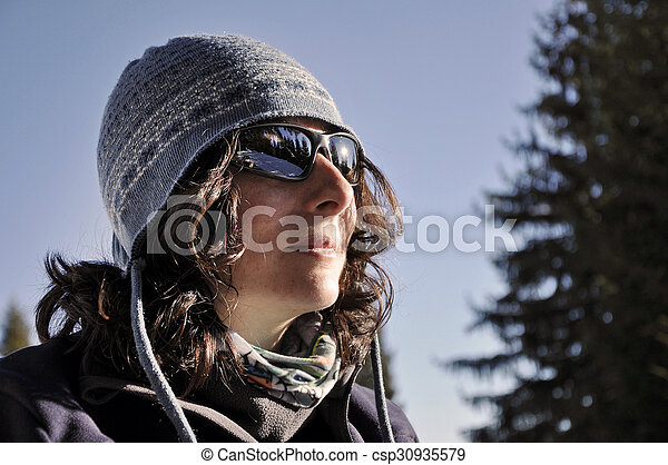 Portrait of a young woman with sunglasses at winter - csp30935579
