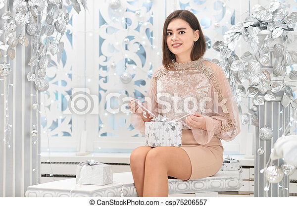 Portrait of a young woman with present box - csp75206557