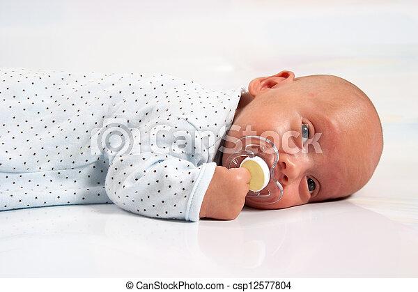 Portrait of Adorable Baby Boy Sucking - csp12577804