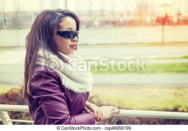 portrait of african american young woman outdoor in wintertime - csp46956199