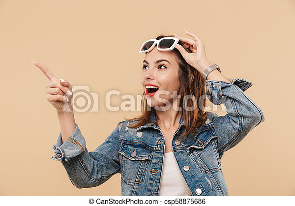 Portrait of an amazed young girl in summer clothes - csp58875686