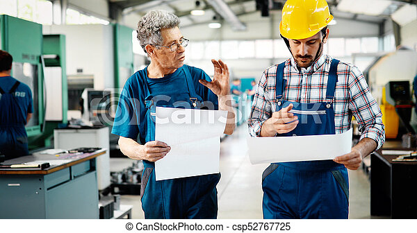 Portrait of an handsome engineer in a factory - csp52767725
