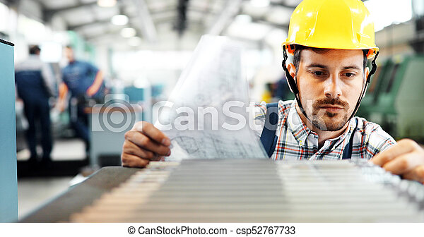 Portrait of an handsome engineer in a factory - csp52767733