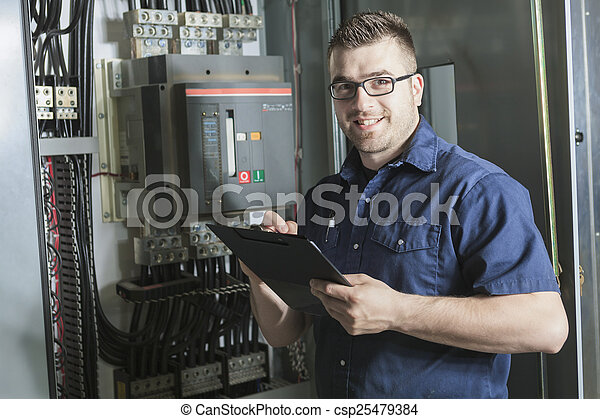 Portrait of an happy worker in a factory - csp25479384