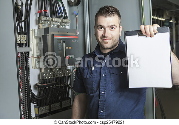 Portrait of an happy worker in a factory - csp25479221