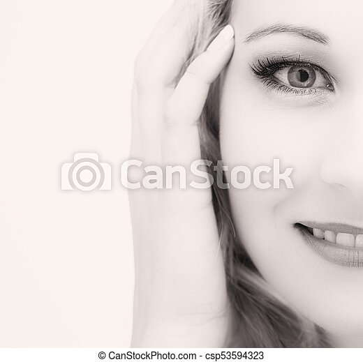 Portrait of an isolated friendly blond woman in high key artistic conversion - csp53594323