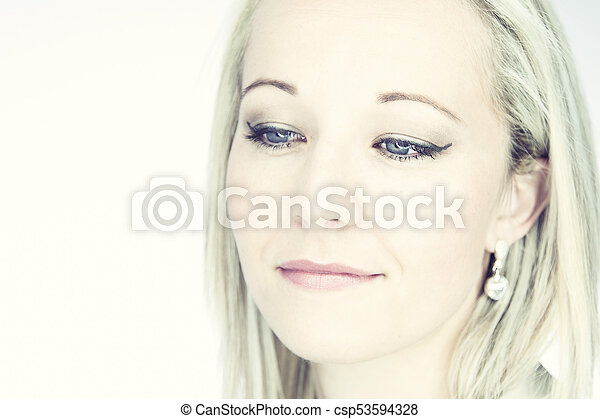 Portrait of an isolated friendly blond woman with blue eyes in artistic conversion - csp53594328