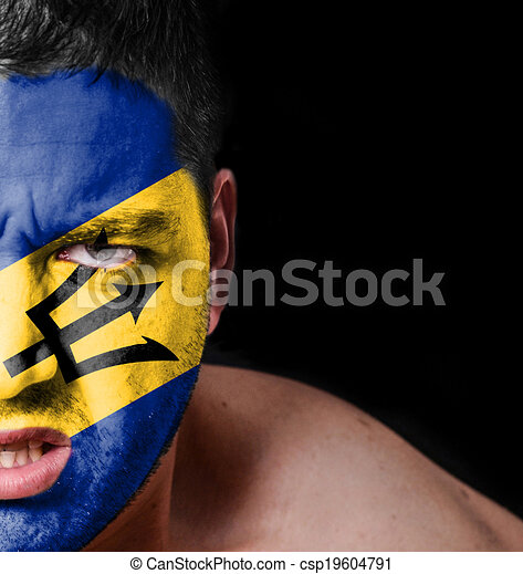 Portrait of angry man with painted flag of Barbados - csp19604791