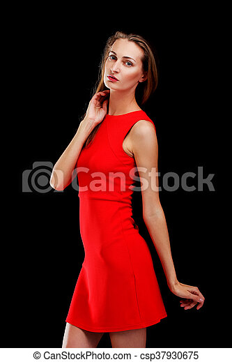 Portrait of attractive woman in red dress on black - csp37930675