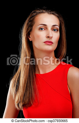 Portrait of attractive woman in red dress on black - csp37930665