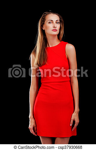 Portrait of attractive woman in red dress on black - csp37930668