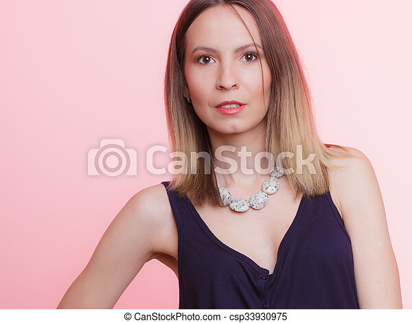 Portrait of attractive woman with necklace - csp33930975