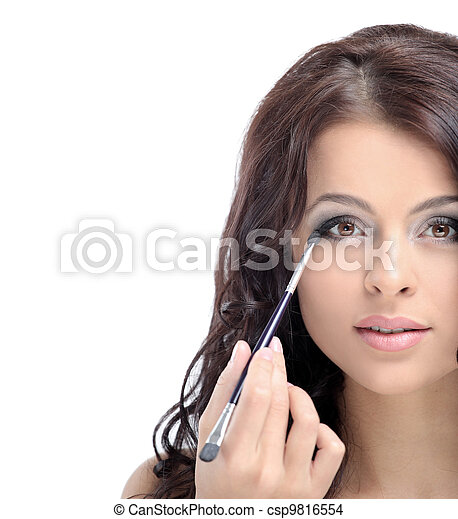 Portrait of attractive young adult woman applying blusher - csp9816554