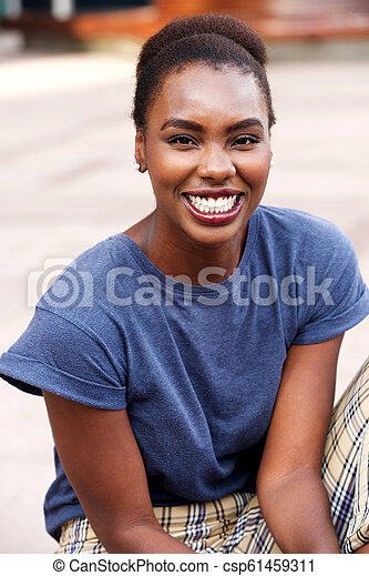 Portrait of attractive young african american woman smiling - csp61459311