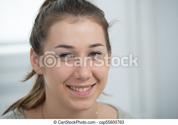 portrait of beautiful and smiling young woman - csp55600763