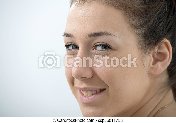 portrait of beautiful and smiling young woman - csp55811758