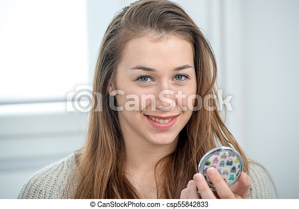 portrait of beautiful and smiling young woman - csp55842833