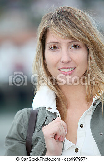 Portrait of beautiful blond woman in town - csp9979574