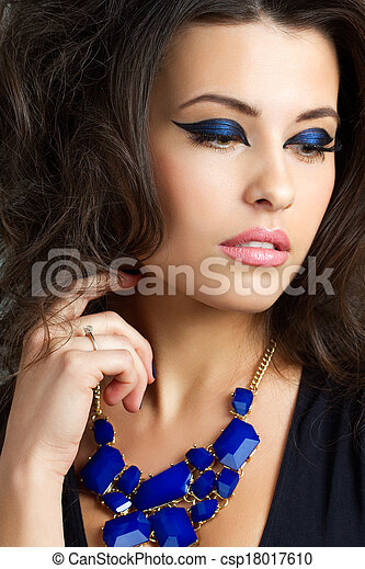 Portrait of beautiful brunet woman - csp18017610