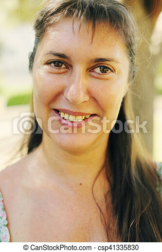 Portrait Of Beautiful Real 45 Years Old Woman In The Park