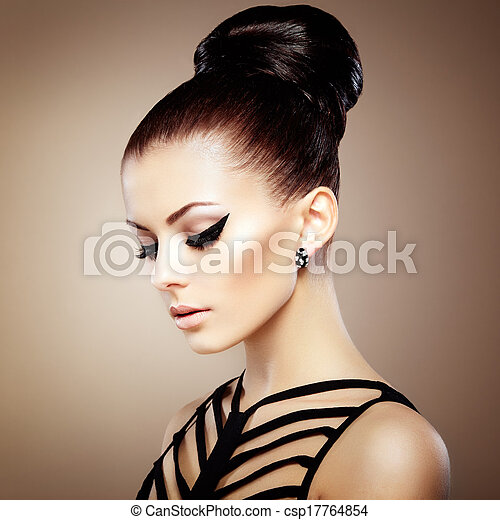 Portrait of beautiful sensual woman with elegant hairstyle. Perfect makeup. Fashion photo - csp17764854