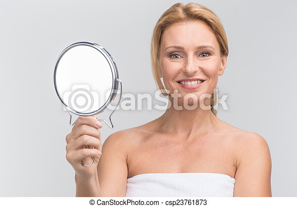 Woman Holding Mirror With Portrait Of Beautiful Woman Holding Mirror Smiling Looking At Camera On White Csp23761873