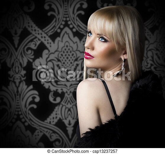 Portrait of beautiful woman in luxury fur coat - csp13237257