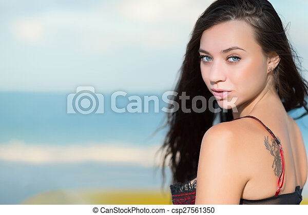 Portrait of beautiful young brunette with tattoo - csp27561350