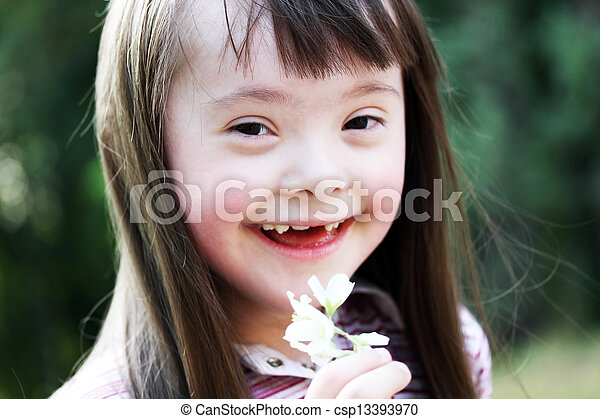 Portrait of beautiful young girl with flowers in the park - csp13393970