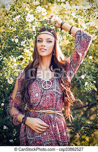 Portrait of beautiful young hippie girl among the flowers. Portrait ... 129d07328142